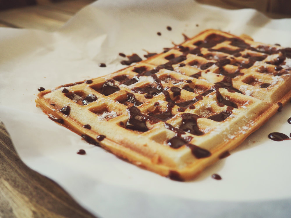 Waffles covered in chocolate syrup. (Retrieved from Pexels.com)