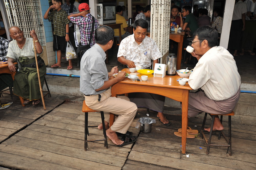 Gentlemen drinking tea at a tea shop. Contributed by Kootour.