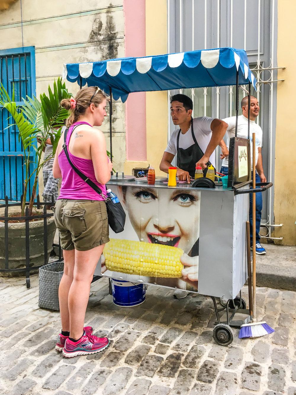 Ordering corn from a food vendor in Havana