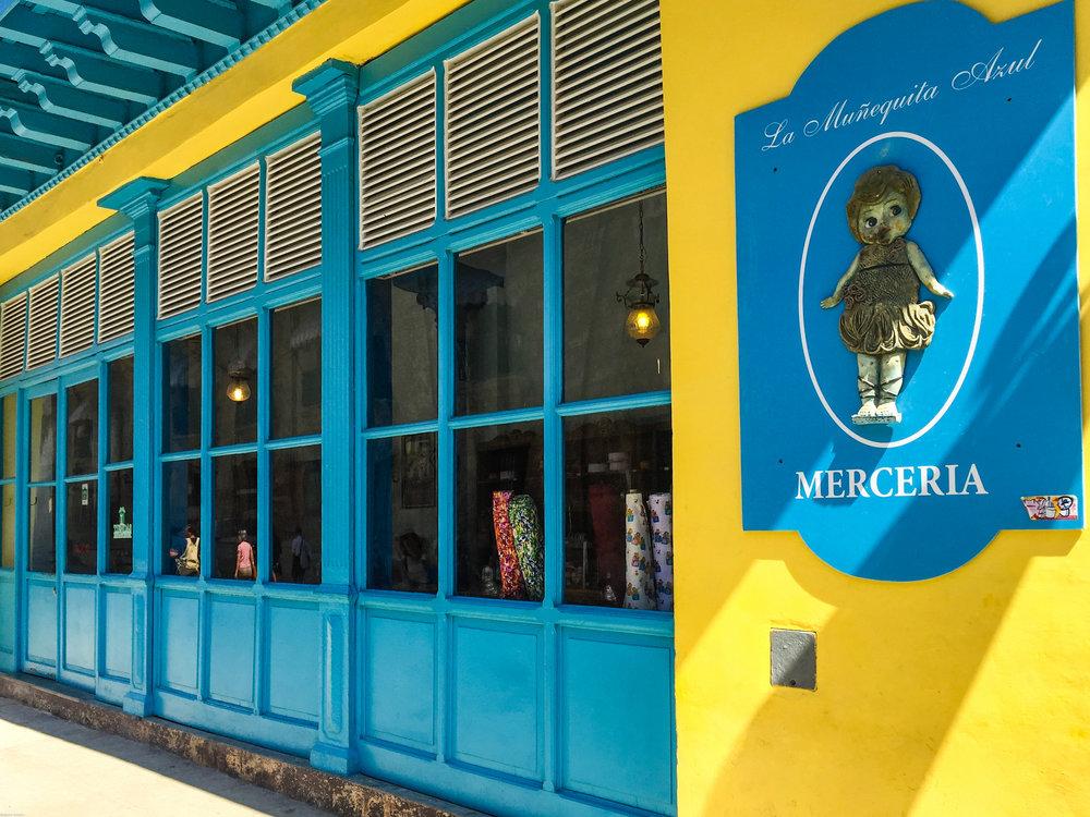 La Munequita Azul, a brightly colored antique store