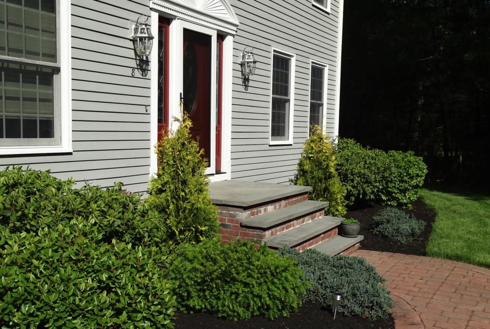Front yard landscaping with quality landscape maintenance service in Millis MA