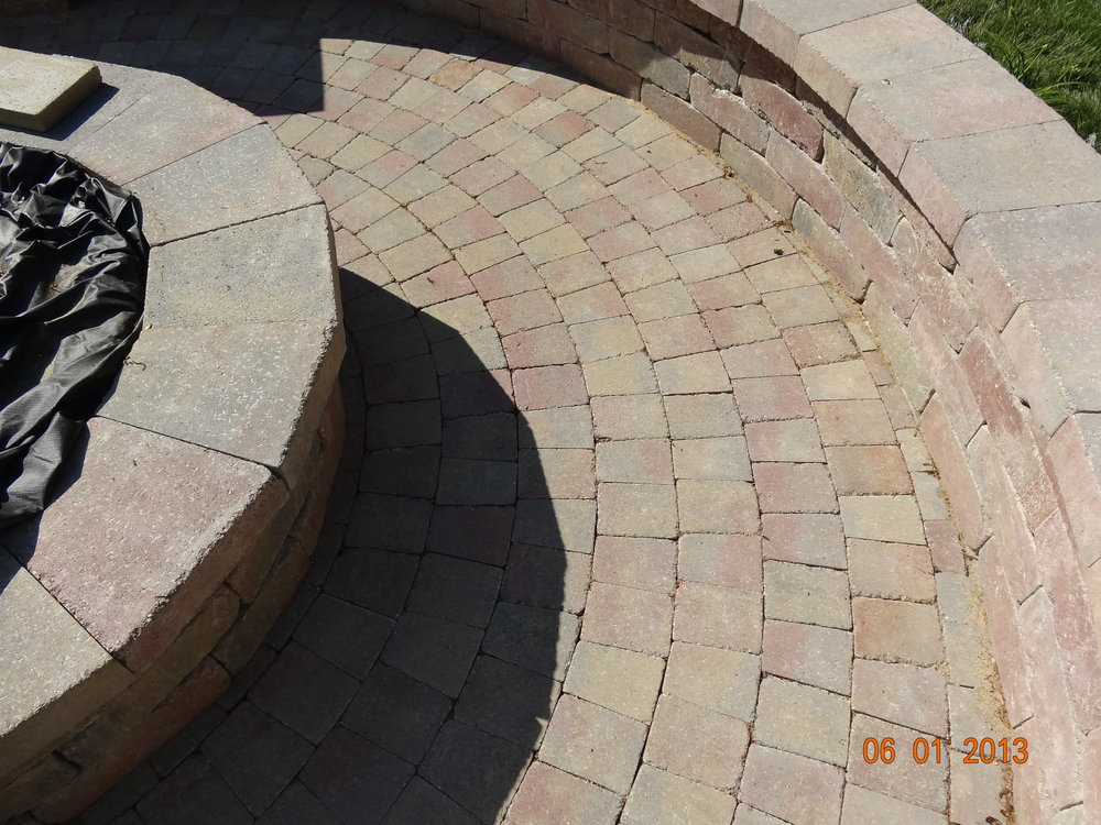 Professional patio installation with outdoor fireplace in Needham Massachusetts