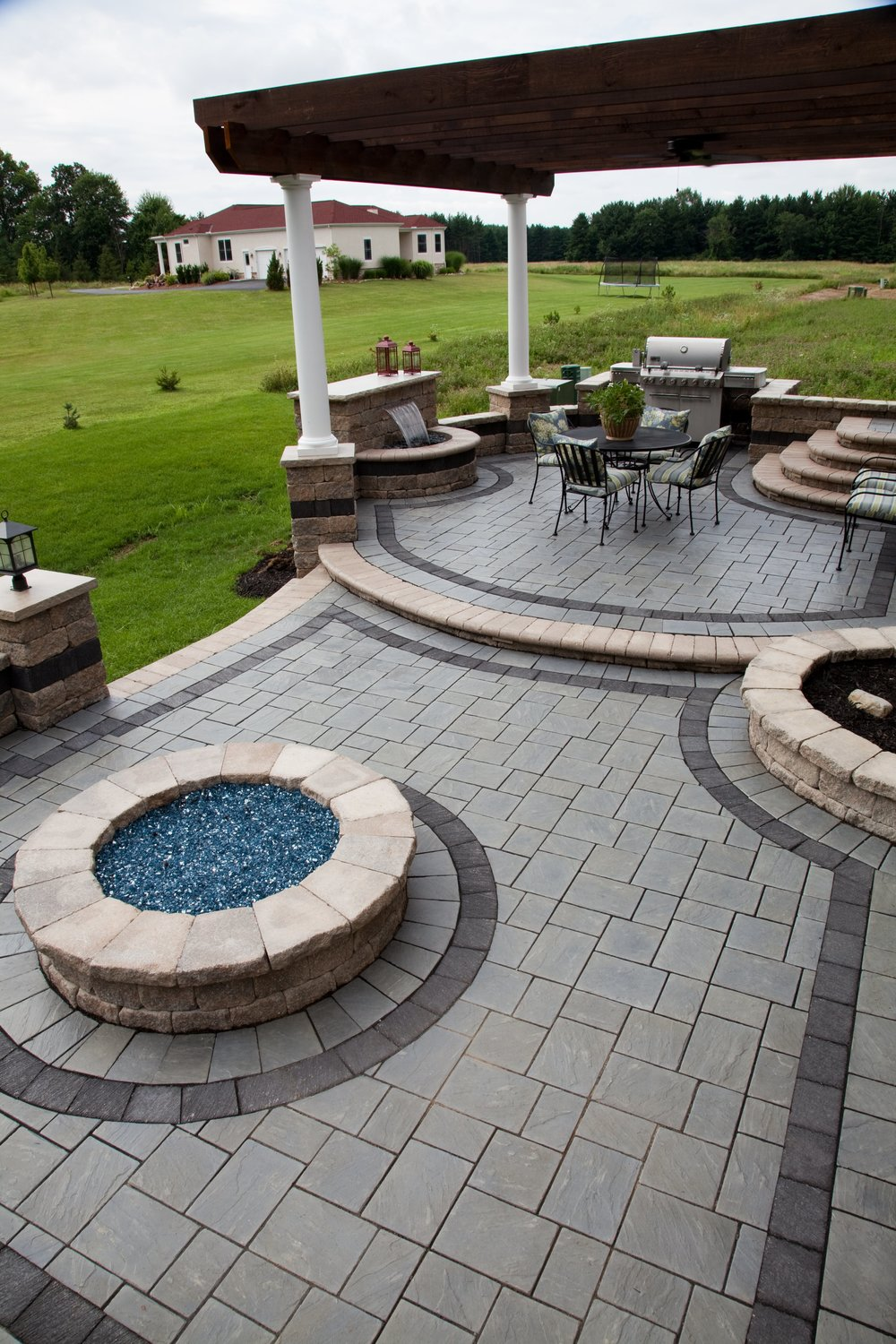 Quality patio installation with outdoor fireplace in Weston MA