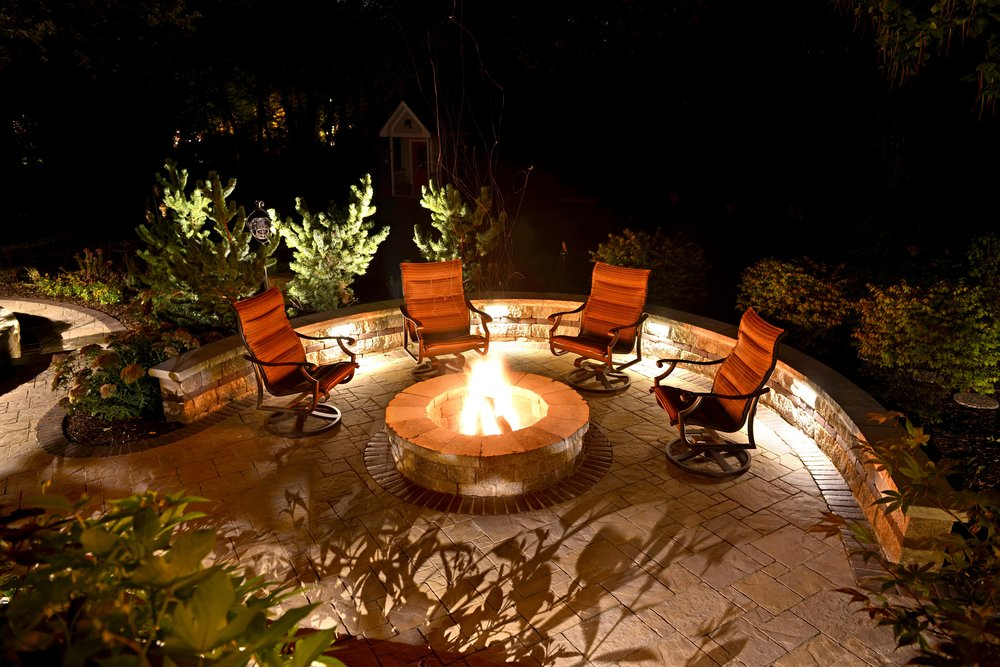 Stunning outdoor fireplace landscape design in Chestnut Hill Massachusetts