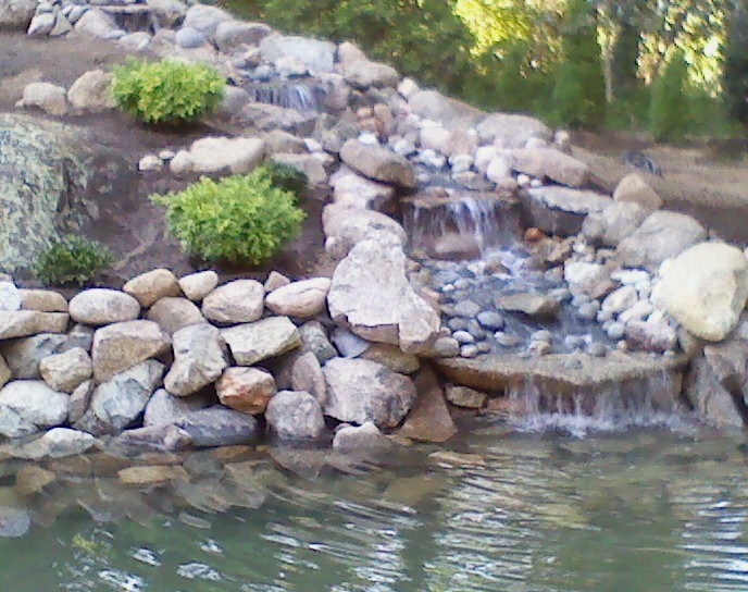 Front yard landscaping with stunning water features in Norfolk MA