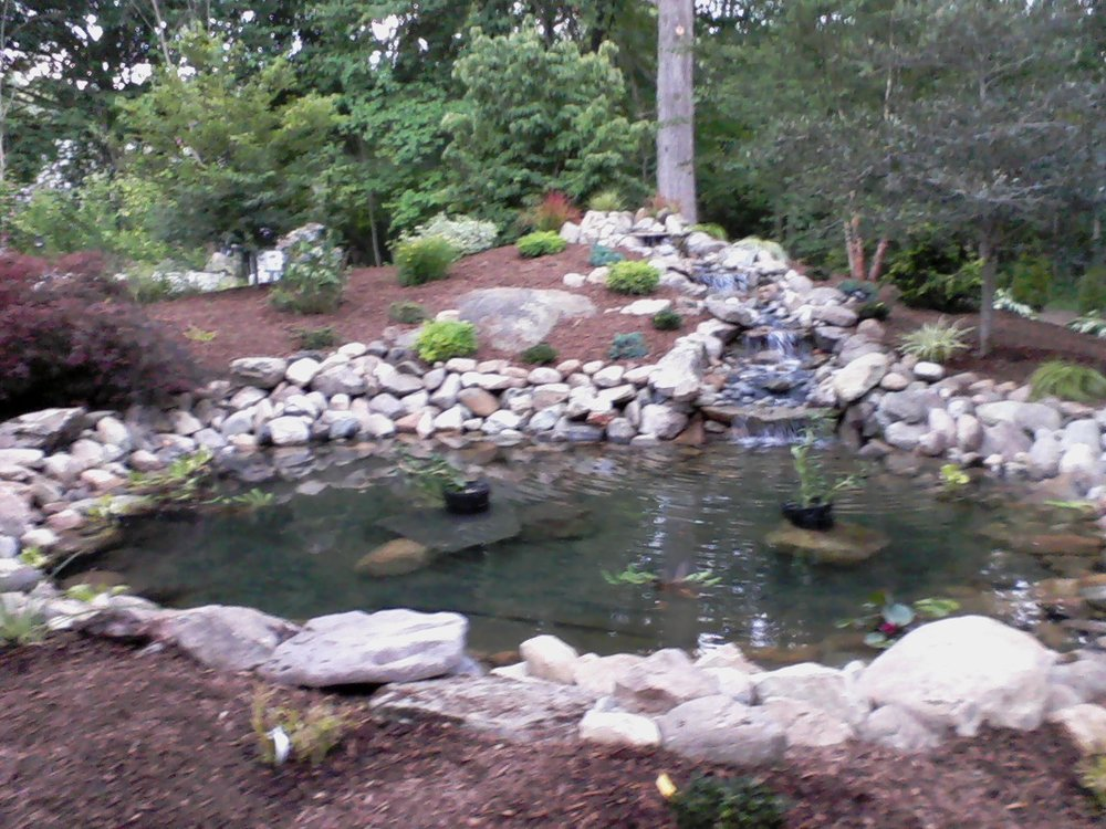 Landscape design with beautiful water features in Weston MA