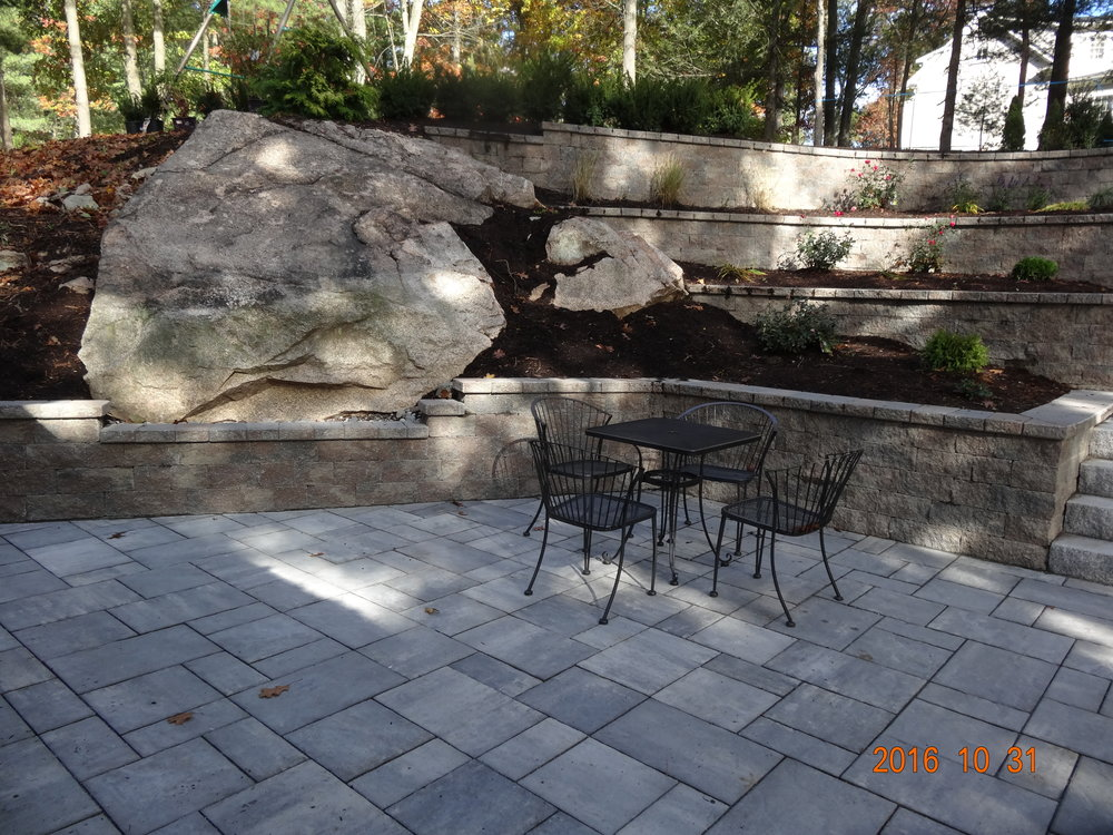 Professional patio installation with retaining wall in Needham MA
