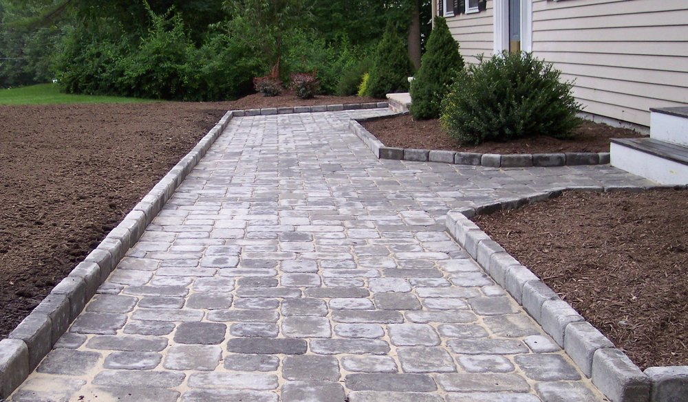 Front yard landscaping with beautiful walkway in Needham, MA.