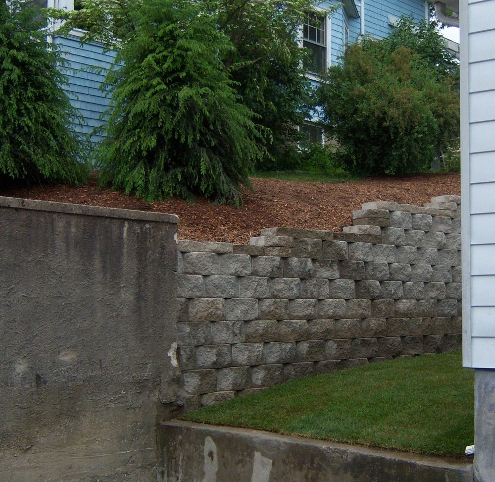 Landscape maintenance for retaining wall and lawn care in Millis, MA
