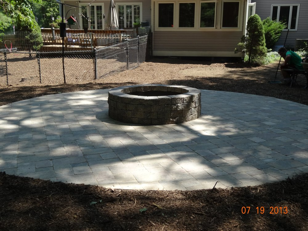 Patio installation with outdoor fireplace in Norfolk MA