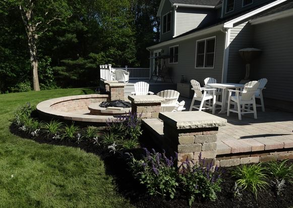 Top patio installation with retaining wall in Sharon Massachusetts