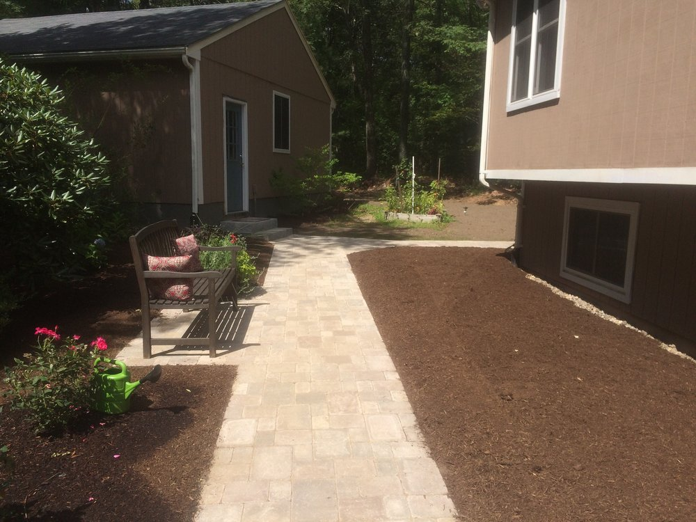 Walkway leading to stunning outdoor kitchen in Newton Massachusetts
