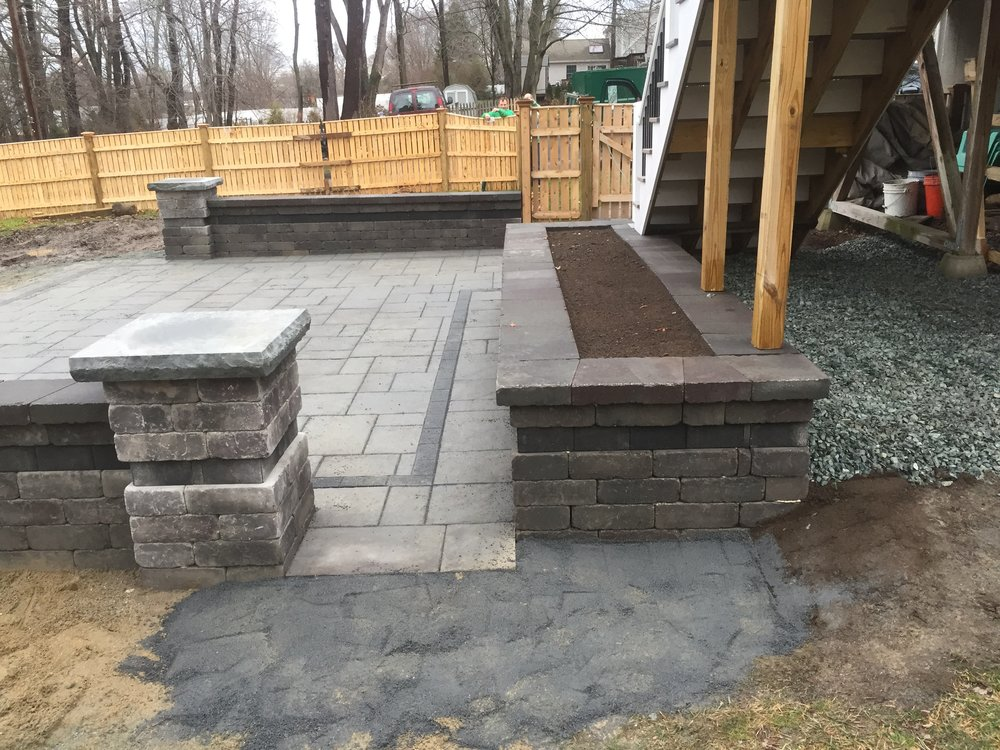 Patio installation with outdoor kitchen in Millis Massachusetts
