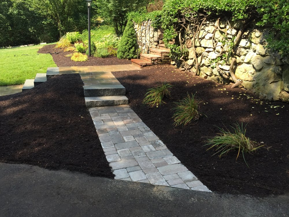Walkway leading the way to stunning outdoor kitchen in Chestnut Hill Massachusetts