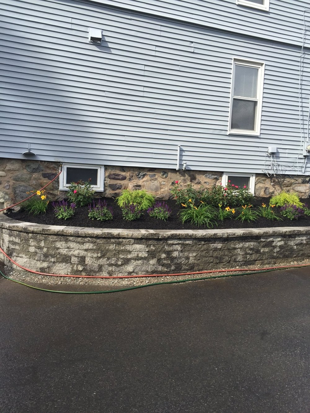 Landscape design with quality retaining wall in Millis Massachusetts