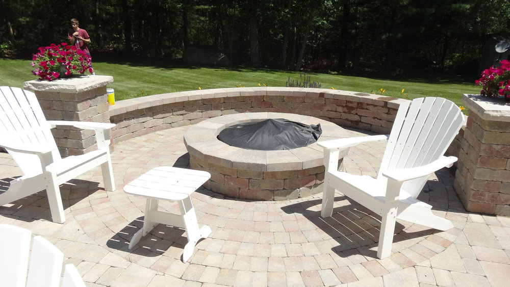 Stunning outdoor fireplace added to patio installation in Chestnut Hill, MA