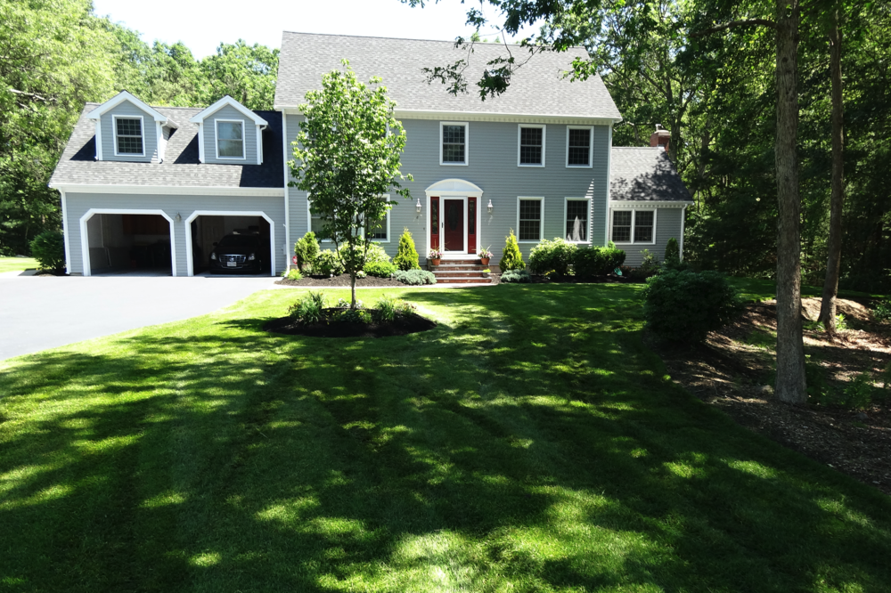 Beautiful landscape design with driveway in Sudbury, MA