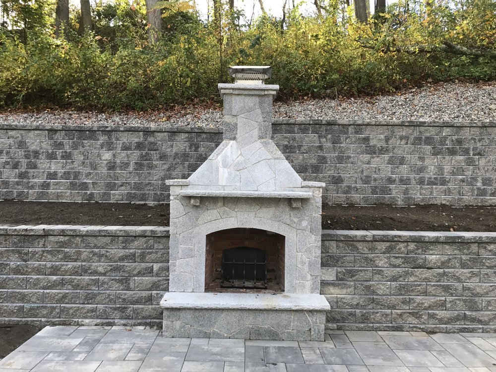 5 Different Outdoor Fireplace and Fire Pit Designs to Consider for Your Millis, MA, Landscape
