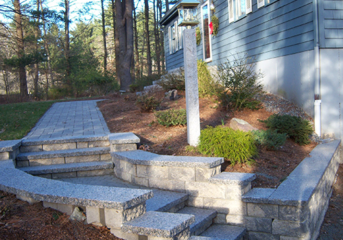 Front yard landscaping with walkway in Norfolk MA on display