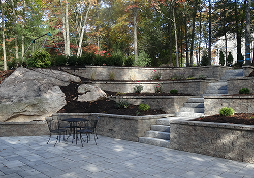 Patio installation with retaining wall in Weston MA