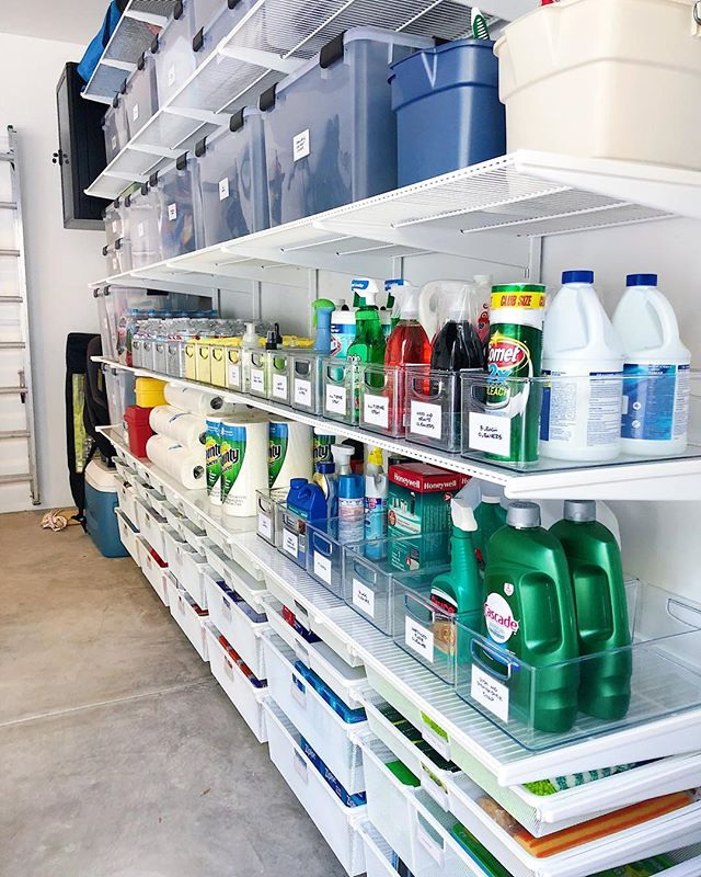 """Idk about you but buying cleaning supplies in bulk and lining them up perfectly is legit one of my favorite activities.  When we finished this garage my client said, """"it looks like Costco!"""" I took that as a compliment. 😂🤓😍"""
