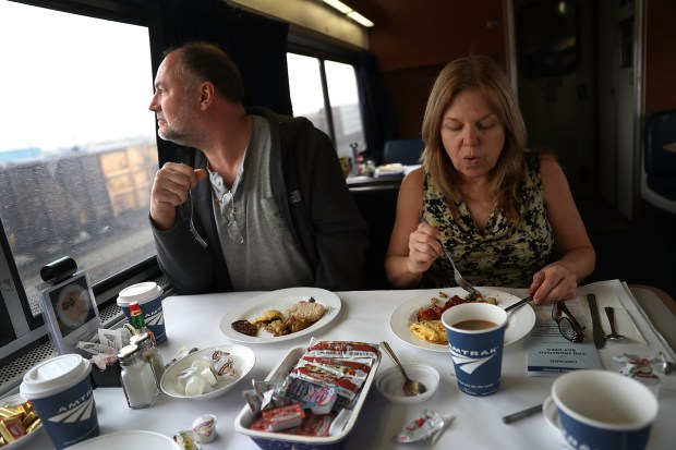 Bill Squier and Julie Blethen eat breakfast on Amtrak's California Zephyr during its daily 2,438-mile trip to Emeryville/San Francisco from Chicago that takes roughly 52 hours on March 24, 2017 in Denver, Colorado.