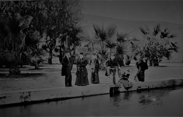 """The tourists posed at the lake at Elysian Park, another new source of pride for recreation and outdoor enjoyment in the city."" -Paul R. Spitzzeri"