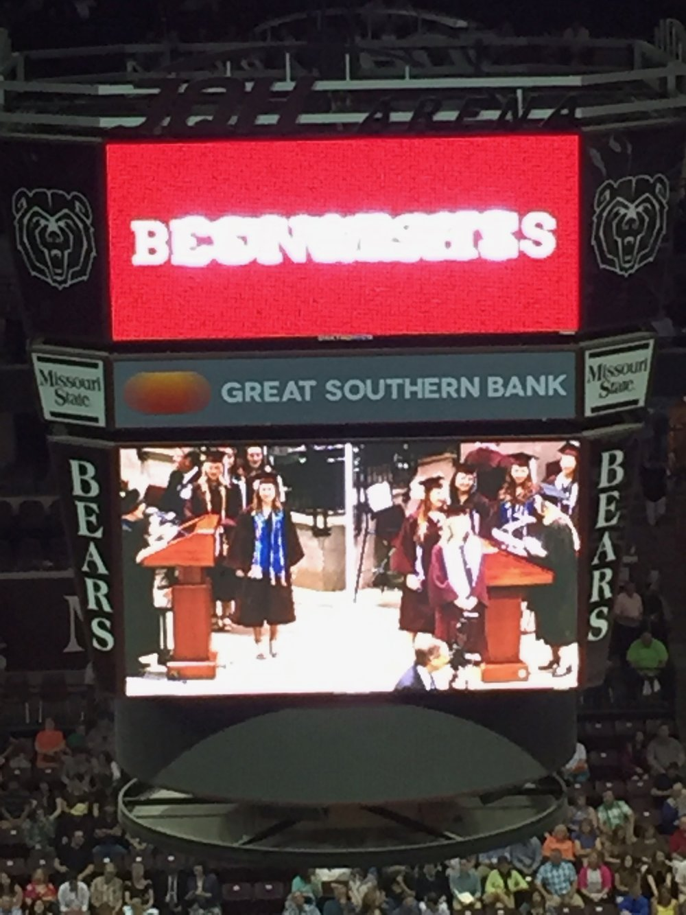 Continuing to uphold the reputation as mom of the group by taking E's photo on the Jumbotron as she walked across the stage (she's on the left with the blue Honors College stole and a bazillion cords because she's brainy and well-loved by alllll the groups).