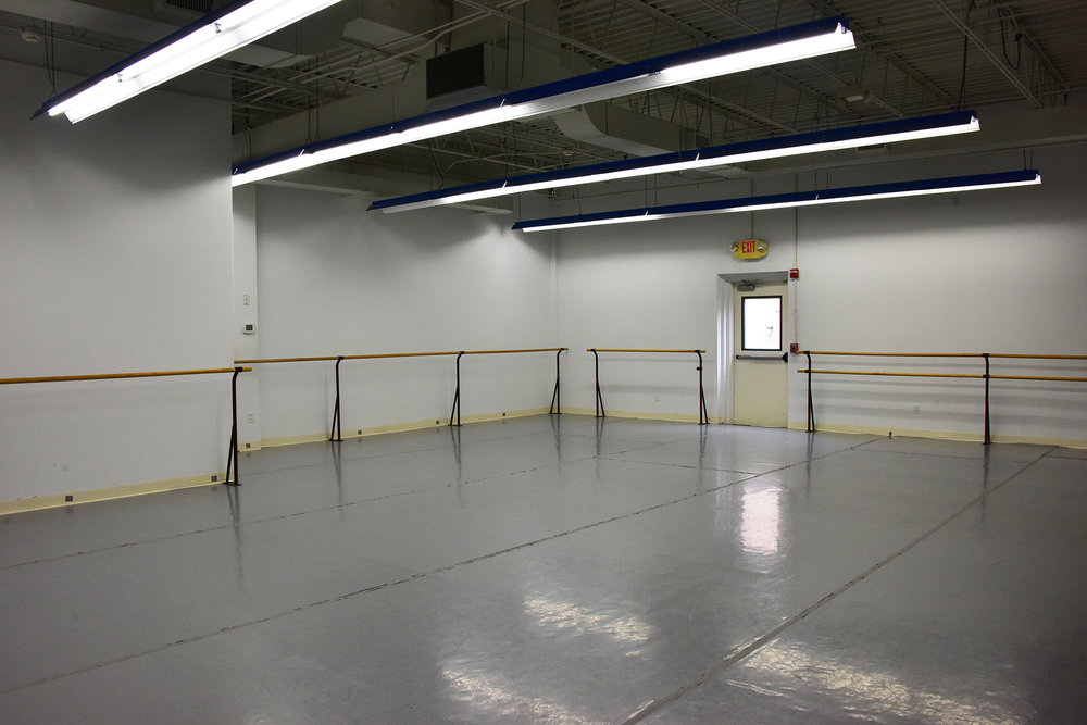 Studio B - 1120 SQ FT - Rate: $40 per hour : Mirrored wall, marley covered floor, dressing rooms, bathrooms, wall mounted barres, freestanding barres, wifi access, wall mounted HD TV with DVD player, stereo with auxiliary and CD capabilities. Central heat/AC, free parking and handicap access.