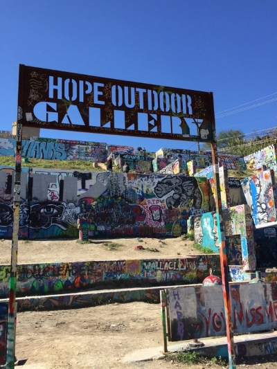 Standing before the entrance to the Hope Outdoor Gallery