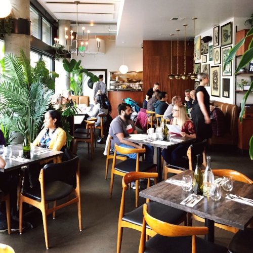 Patrons enjoying brunch at the well-decorated Tallulah's in Capitol Hill
