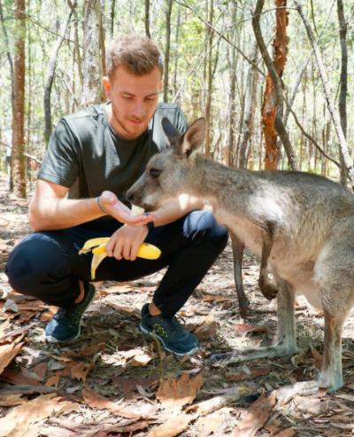 Feeding a kangaroo in Morisset Park in Australia