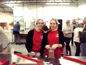 AmeriCorps members pack meals for children overseas at the 2011 MLK Day of Service.