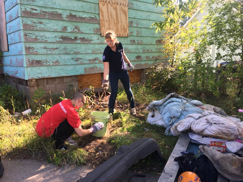 Ecolibrium3 VISTA Corps members completing a joint day of service to clean an abandoned property in Duluth, MN.