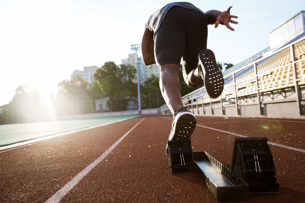 storyblocks-back-view-of-a-young-male-athlete-launching-off-the-start-line-in-a-race_BCKHDnpqb.jpg