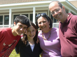 Betsy and Scott pictured with two of their three children, Benjy and Shira.