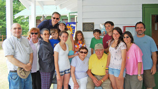 Betty and Irv pictured with four camper grandchildren and one staff grandchild (and the parents of those grandchildren) on Visitors' Day 2009.