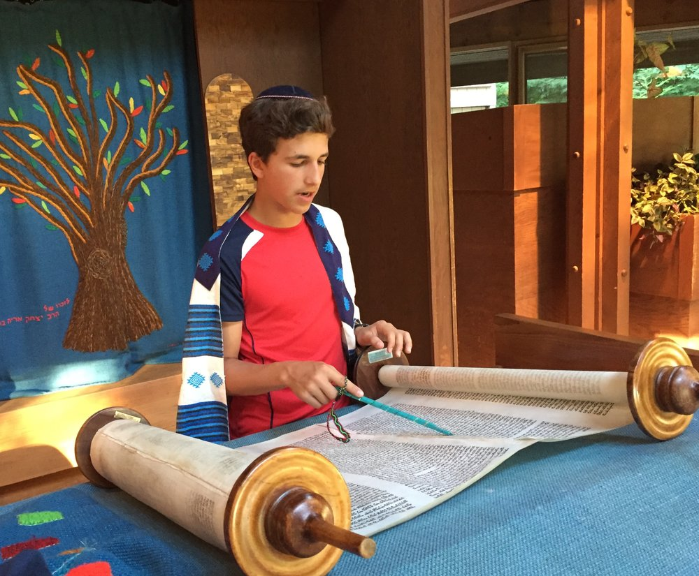 Alex Schapiro practices for his Bar Mitzvah using the Torah from the Memorial Scrolls Trust on permanent loan to Camp Ramah in Wisconsin.
