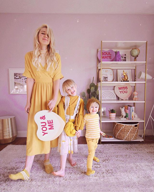 """Gabe walked in and said """"Why are you all wearing yellow?? 🤣"""" Well, why not? 😊 Darcy didn't have a yellow shirt so swipe to see Goldie in the same shirt (which is actually a dress) as a two month old. 😂"""