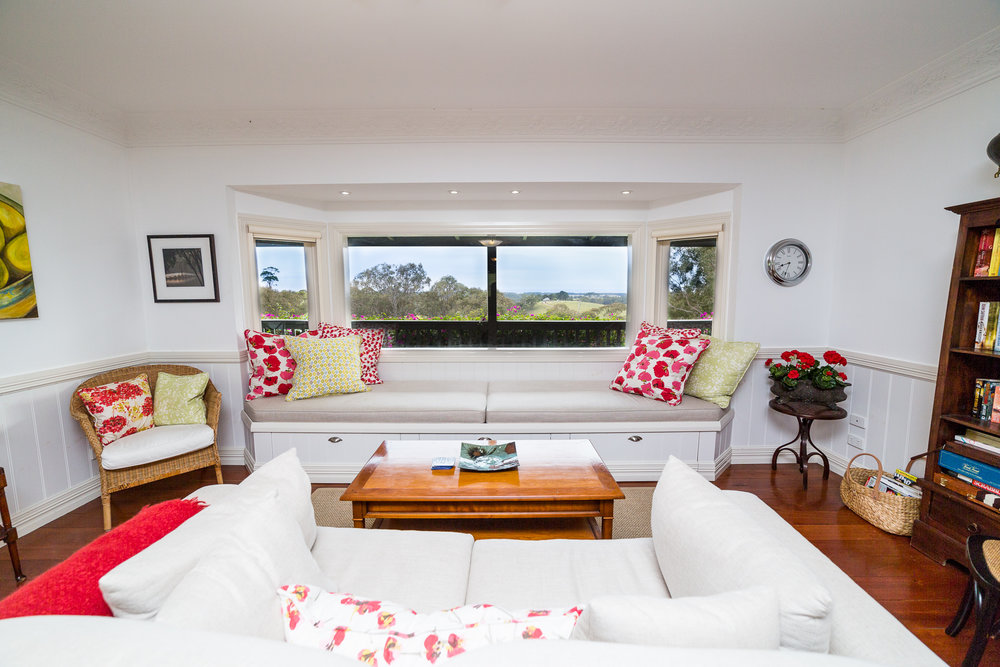 Relax with a board game in the shared living room or look out to sea from the bay window seat