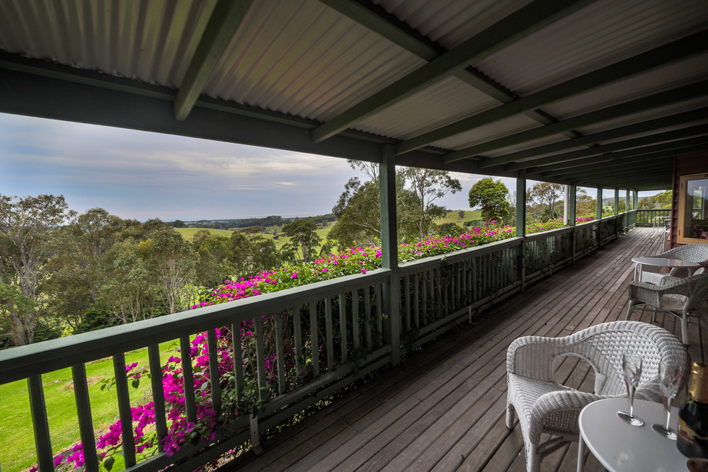 Pastureland and ocean views from the sunny wrap-around verandah