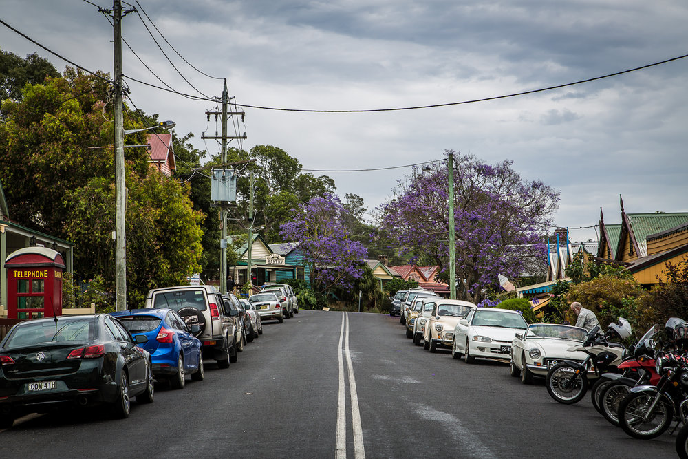 Central Tilba main street, as the Jacarandas flower