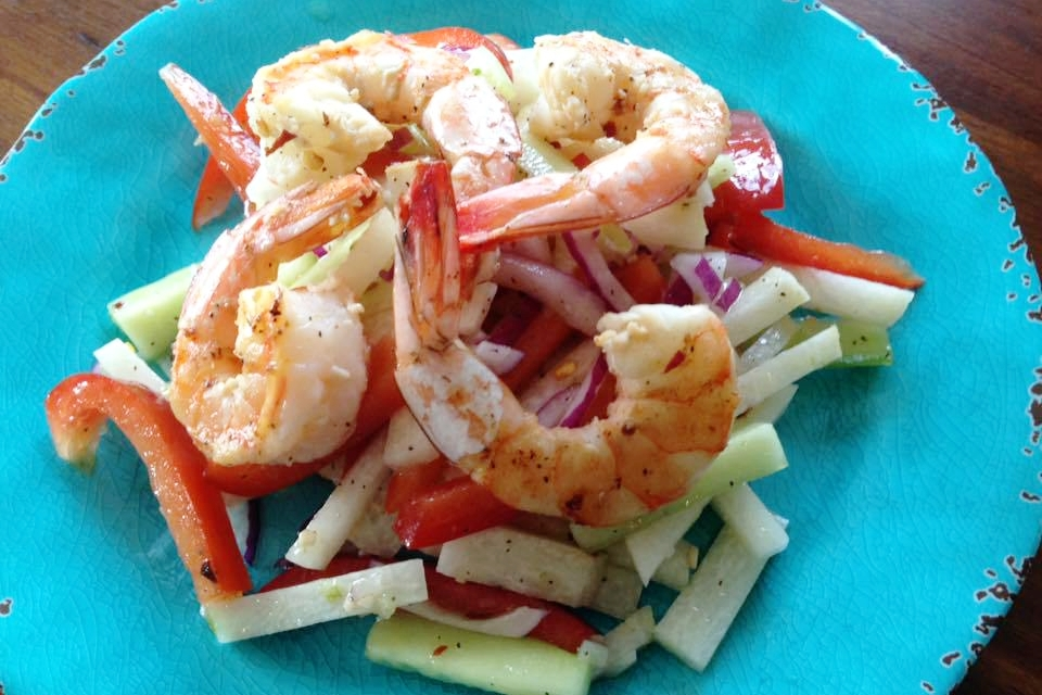 Juicy and succulent grilled shrimp on a bed of tangy jicama, cool cucumber, and bell peppers