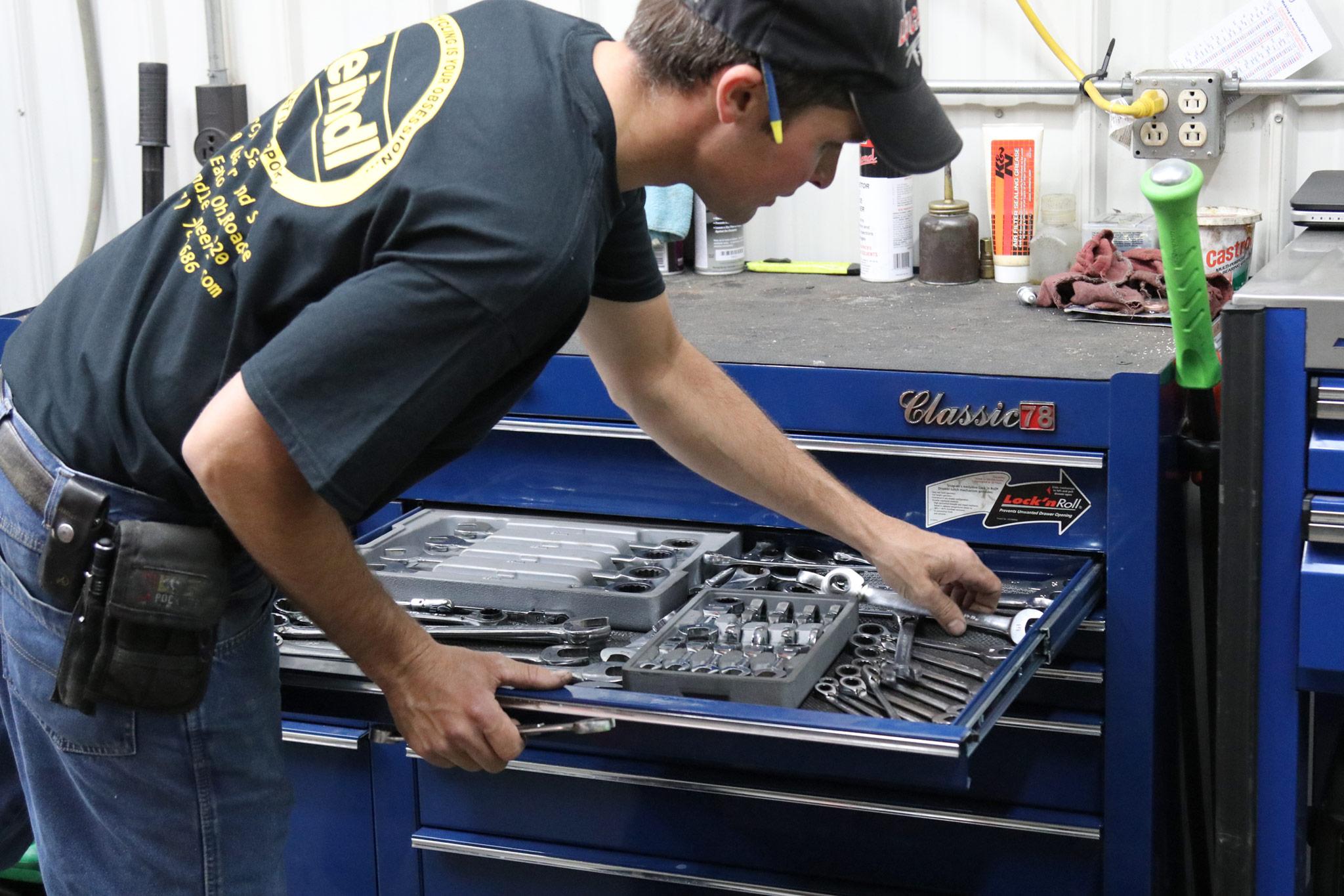 Jon grabbing tools.