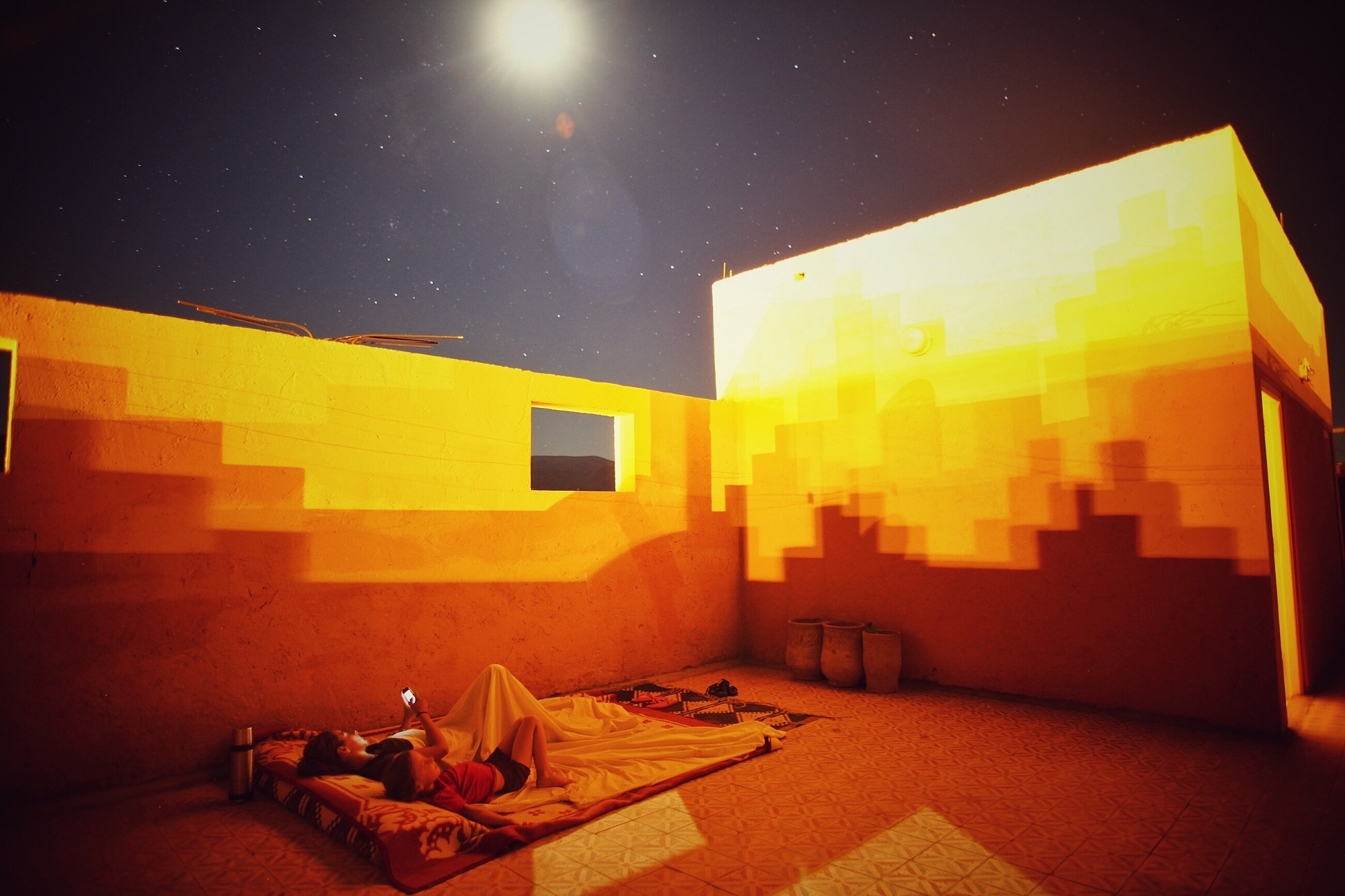 Sleeping on a hotel rooftop, Morocco.