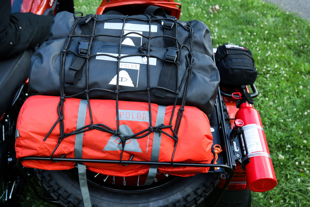 Additional adventure gear included: - Two 10C Sena Motorcycle Bluetooth Camera and Communication SystemsHeidenau K37 Dual Sport TiresOuter Limit Supply First Aid KitPoler Orange Two Man TentTwo Poler High & Dry Waterproof Duffle BagsDrake Off Road Quick-Release Fire Extinguisher Mount