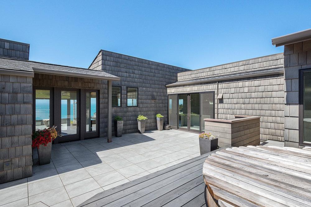 Courtyard with Cedar Hot Tub and Italian Stone Flooring