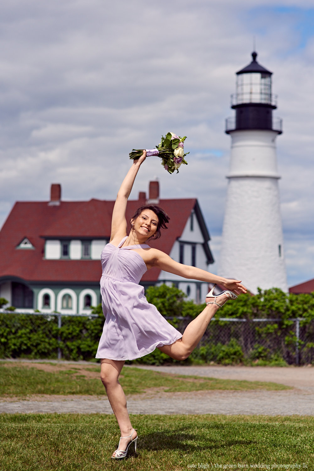 Fun bridesmaid photo in front of a lighthouse in Maine