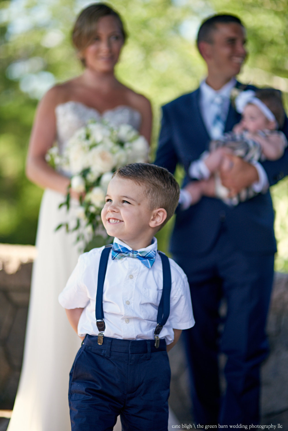 Ring bearer with bride and groom in background NH wedding