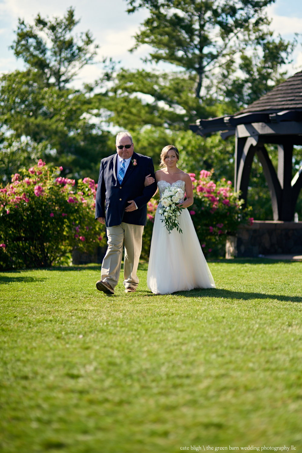 Bride walks down the aisle outdoor wedding Castle in the Clouds NH